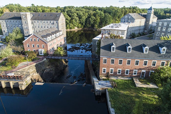 Mill Buildings At The Dam On The Lamprey River In Newmarket, New Hampshire.