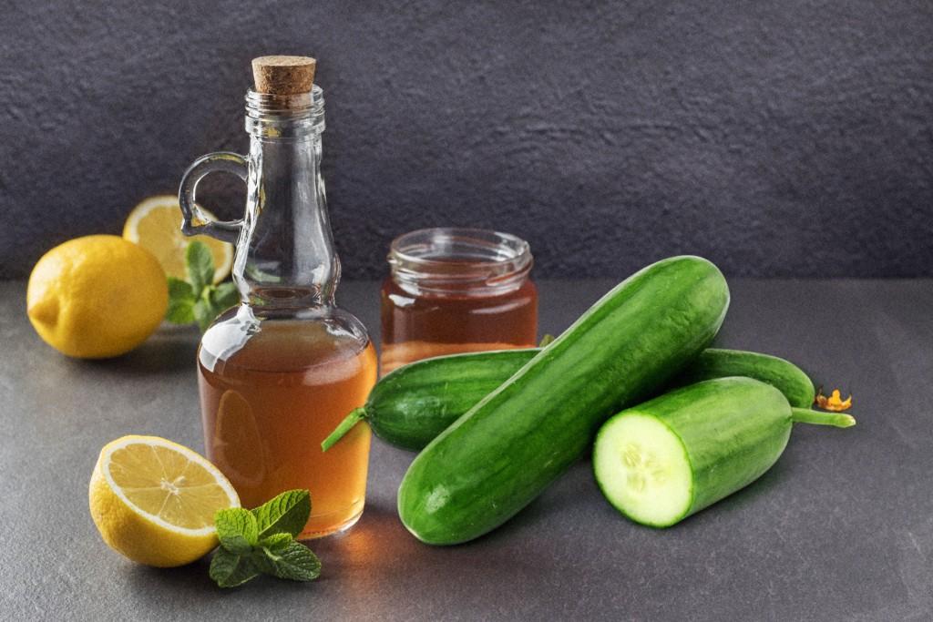 Bottle Of Kombucha Vinegar On Grey Table, Space For Text. Fermented Tea Mushroom Seasoning